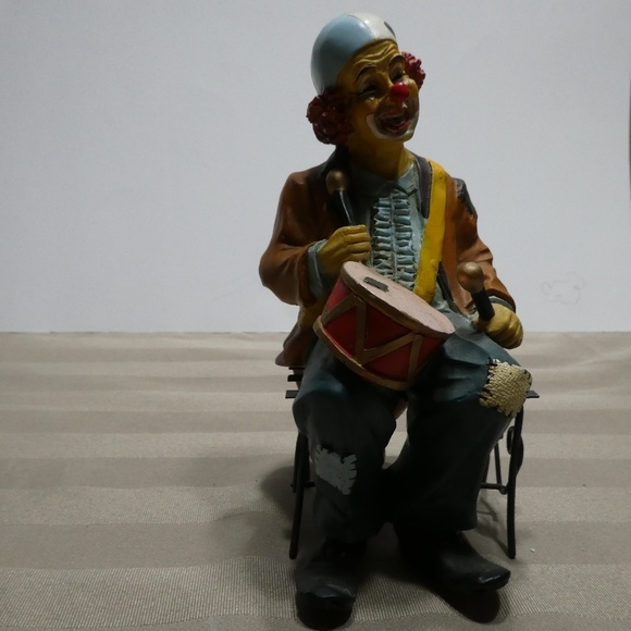 CLOWN porcelain sitting on bench playing the drums